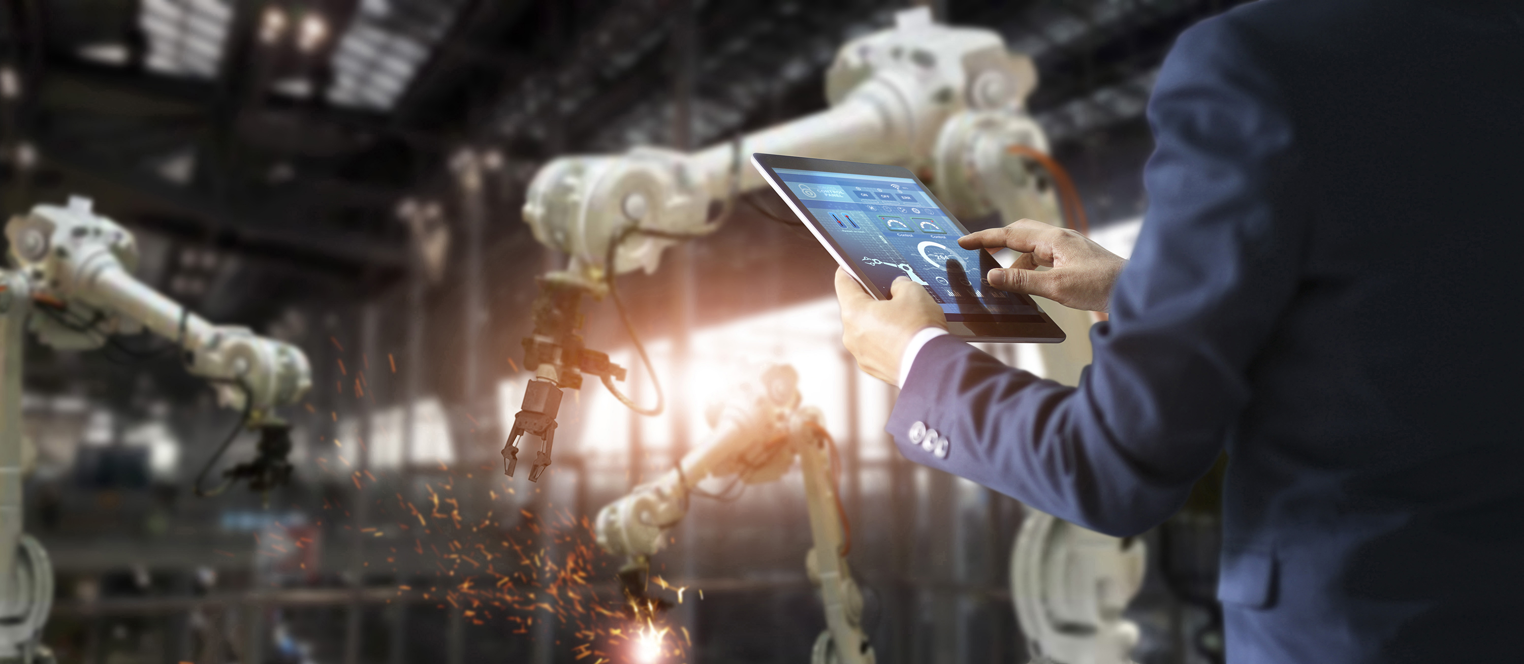 IT manager uses iPad to control robots in a manufacturing setting